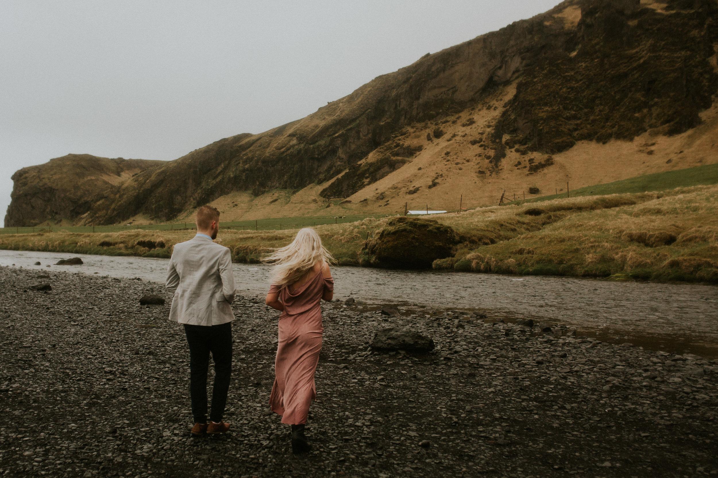 skogafoss couple in iceland engagementphotography breeanna lasher