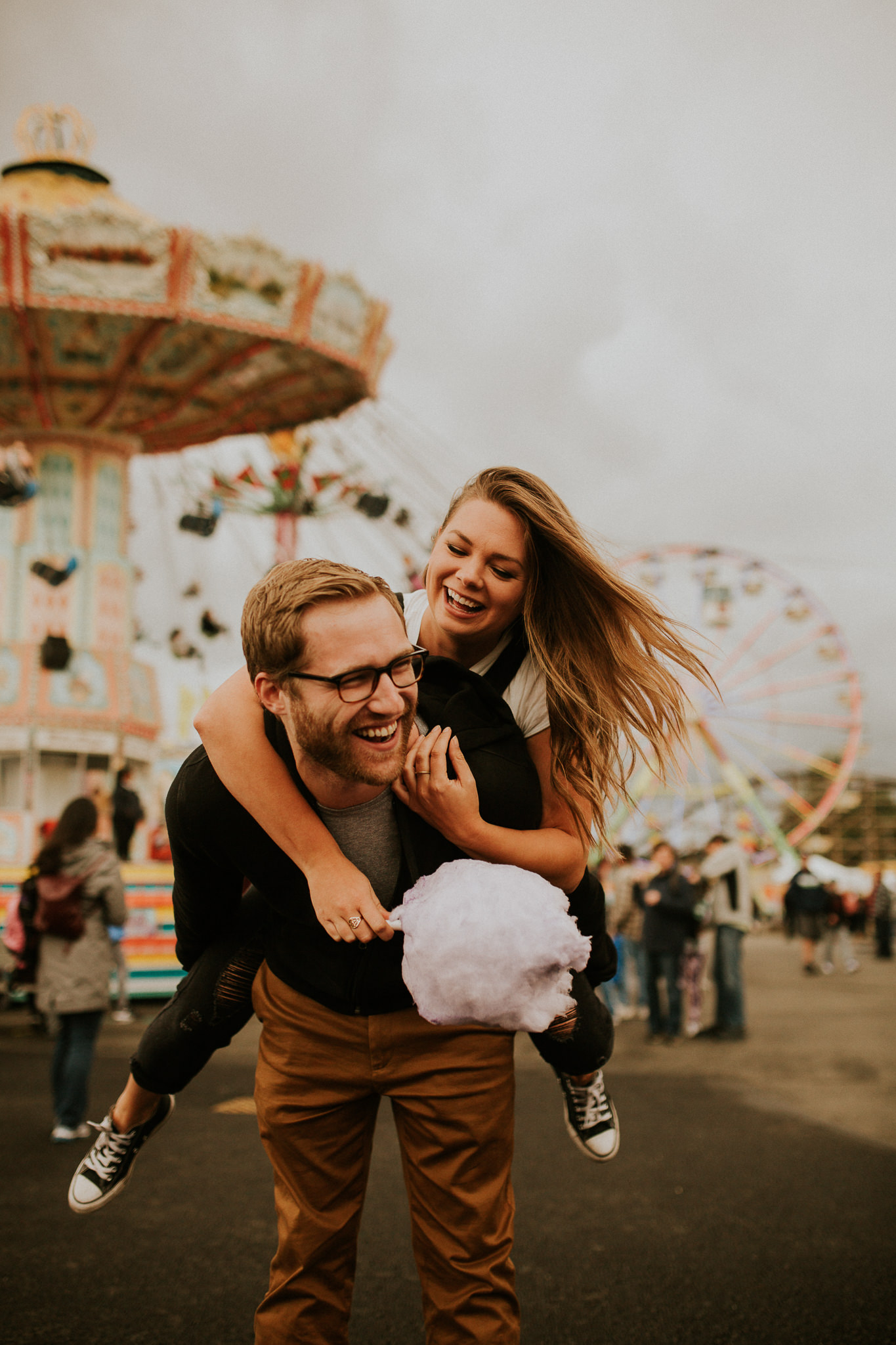 Summer vibe couple having fun at Puyallup fair engagement session for engagement photos.