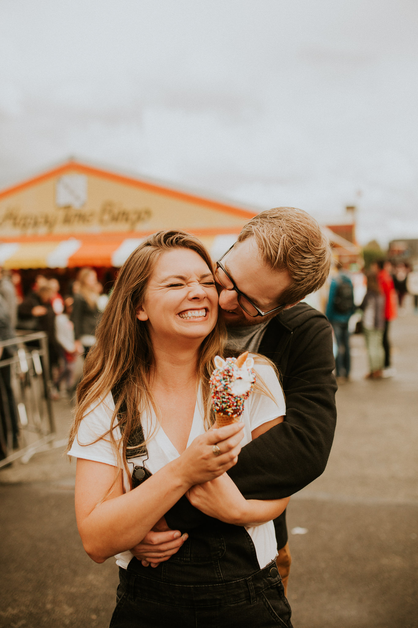 state fair engagement photos with unicorn icecream cone and its super vibey and trendy and would probably get featured on instagram.