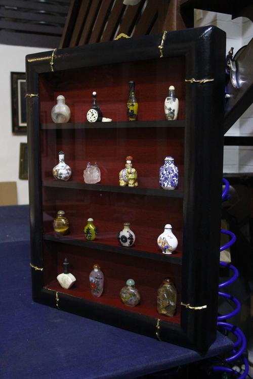 Antique Snuff Bottles framed in hand finished shelf frame