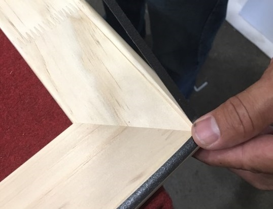 Adding padded rebate tape to canvas frame, creating a padded buffer for a delicate canvas