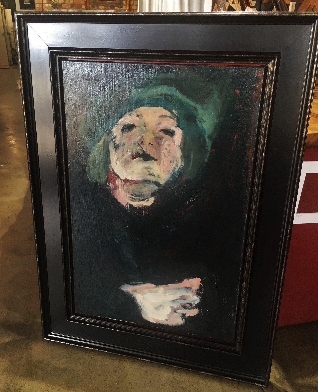 Oil painting in large black casetta frame