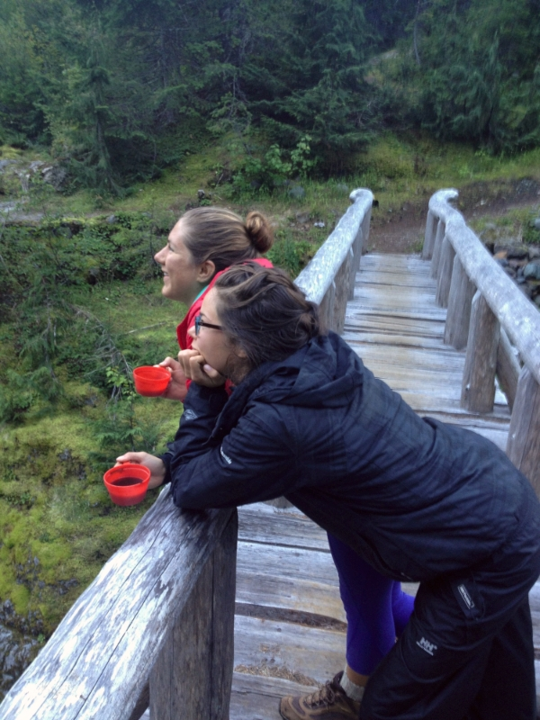 My friend Jenna and I taking a moment to enjoy the sunrise and river with our coffee while hiking the Wonderland Trail around the base of Mt. Rainier.