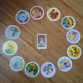 Astrological spread containing  Aquarian Tarot Deck  and  Motherpeace Tarot Deck  cards