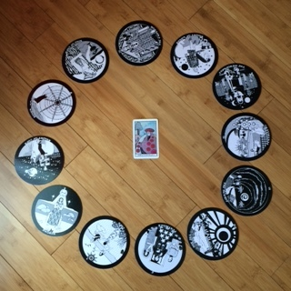 Astrological spread containing  The Gorgon's Tarot  and  Aquarian Tarot cards