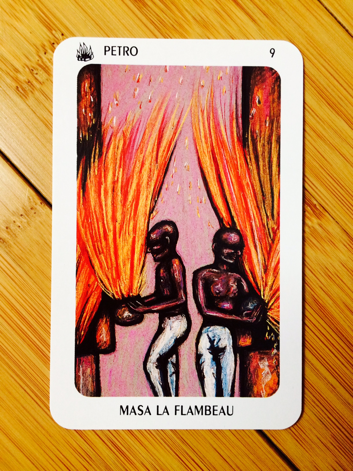 Petro - Masa La Flambeau card from  The New Orleans Voodoo Tarot