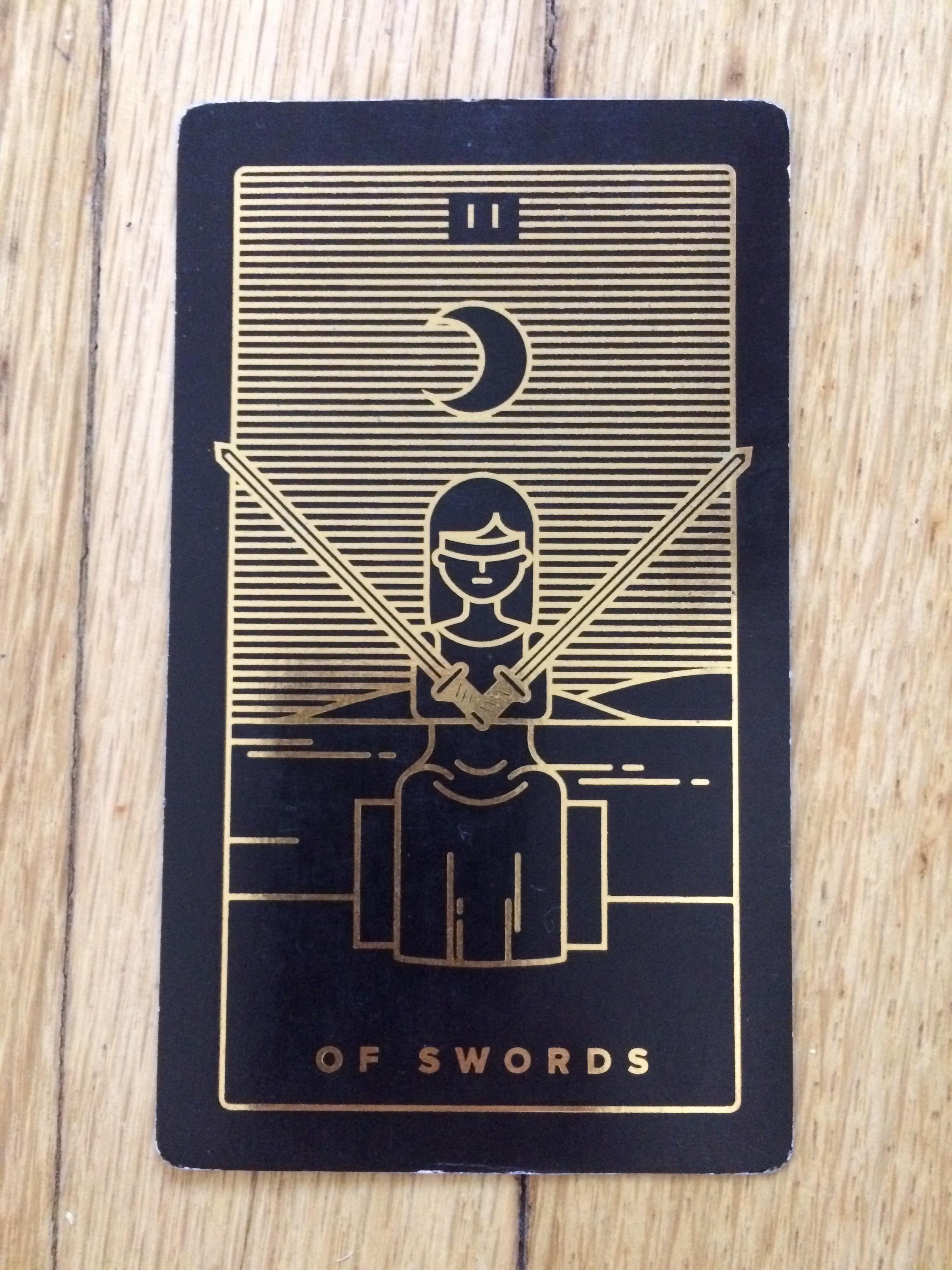 Two of Swords from  Golden Threat Tarot