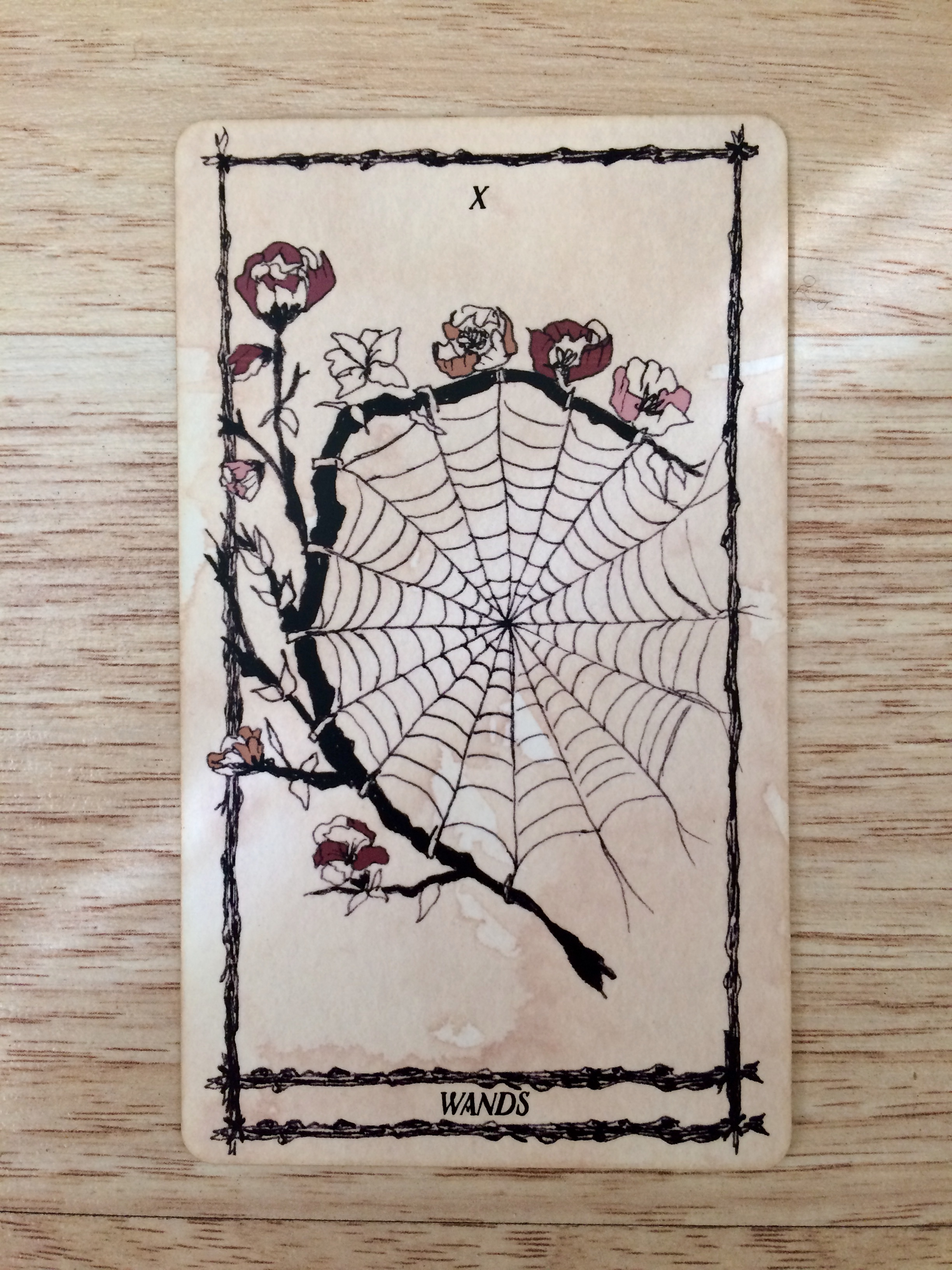 Ten of Wands from  Ophidia Rosa Tarot