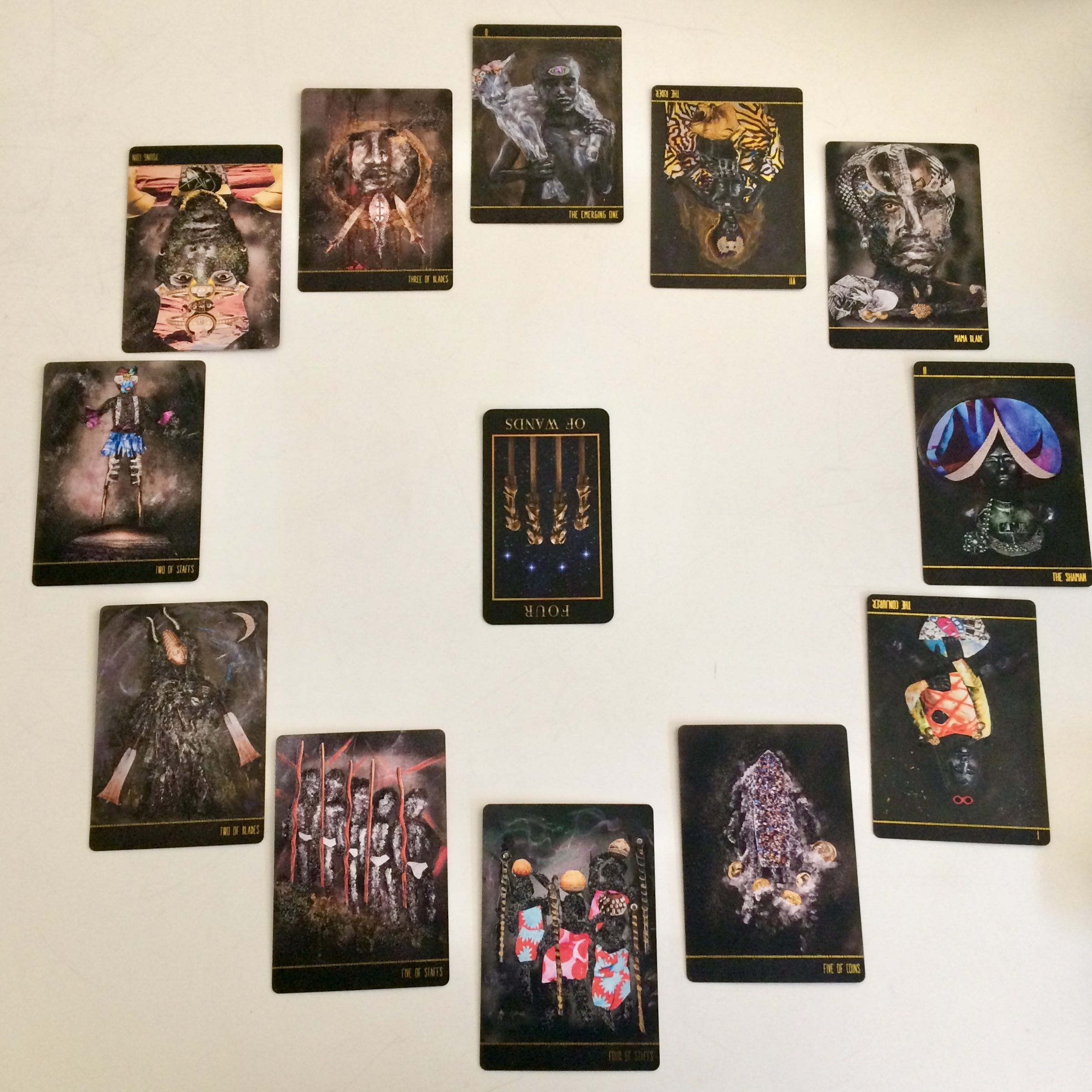 Astrological spread containing cards from  Manzel's Tarot  and  Dust II Onyx