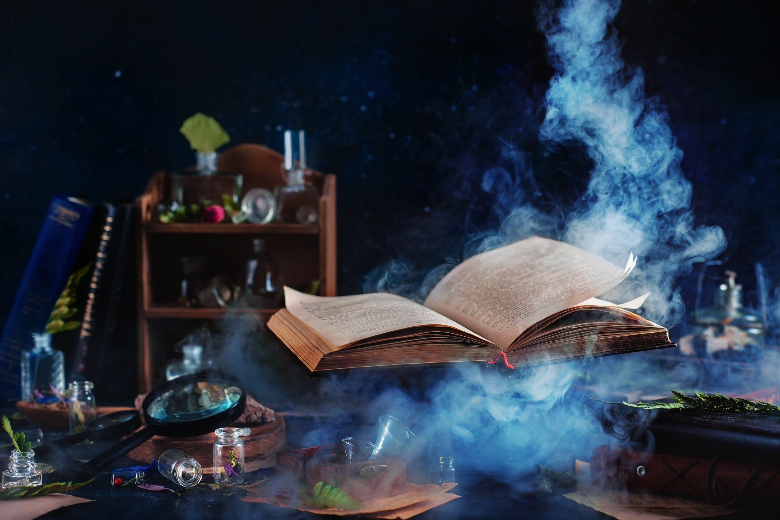 Canva - Flying magical book with smoke.jpg
