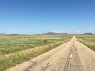 Highway on the plateau of Johnson Mesa, Northern New Mexico    Photograph by Author