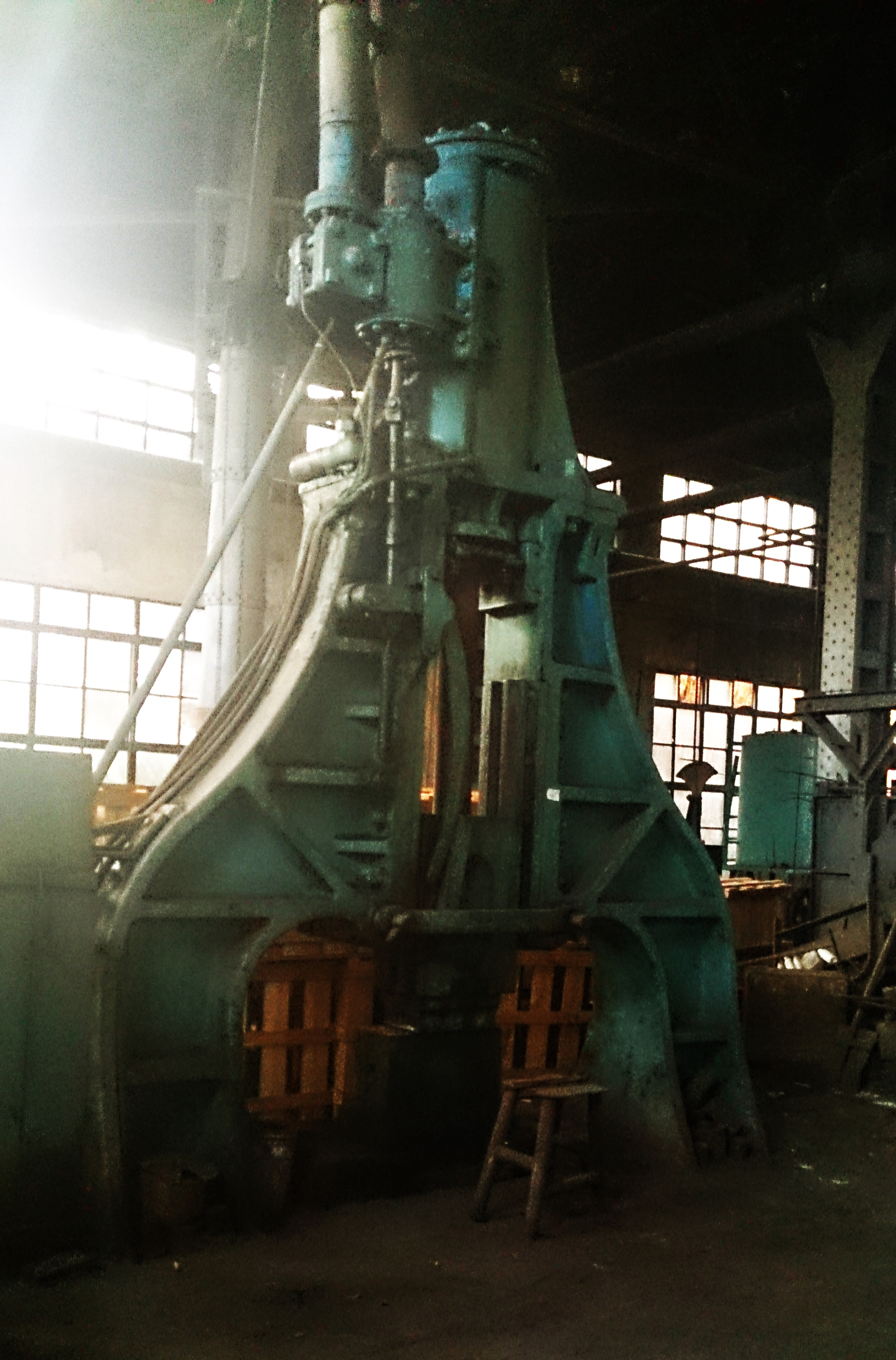 L: The 188- steam hammer. Above and below: Old tools and machinery.