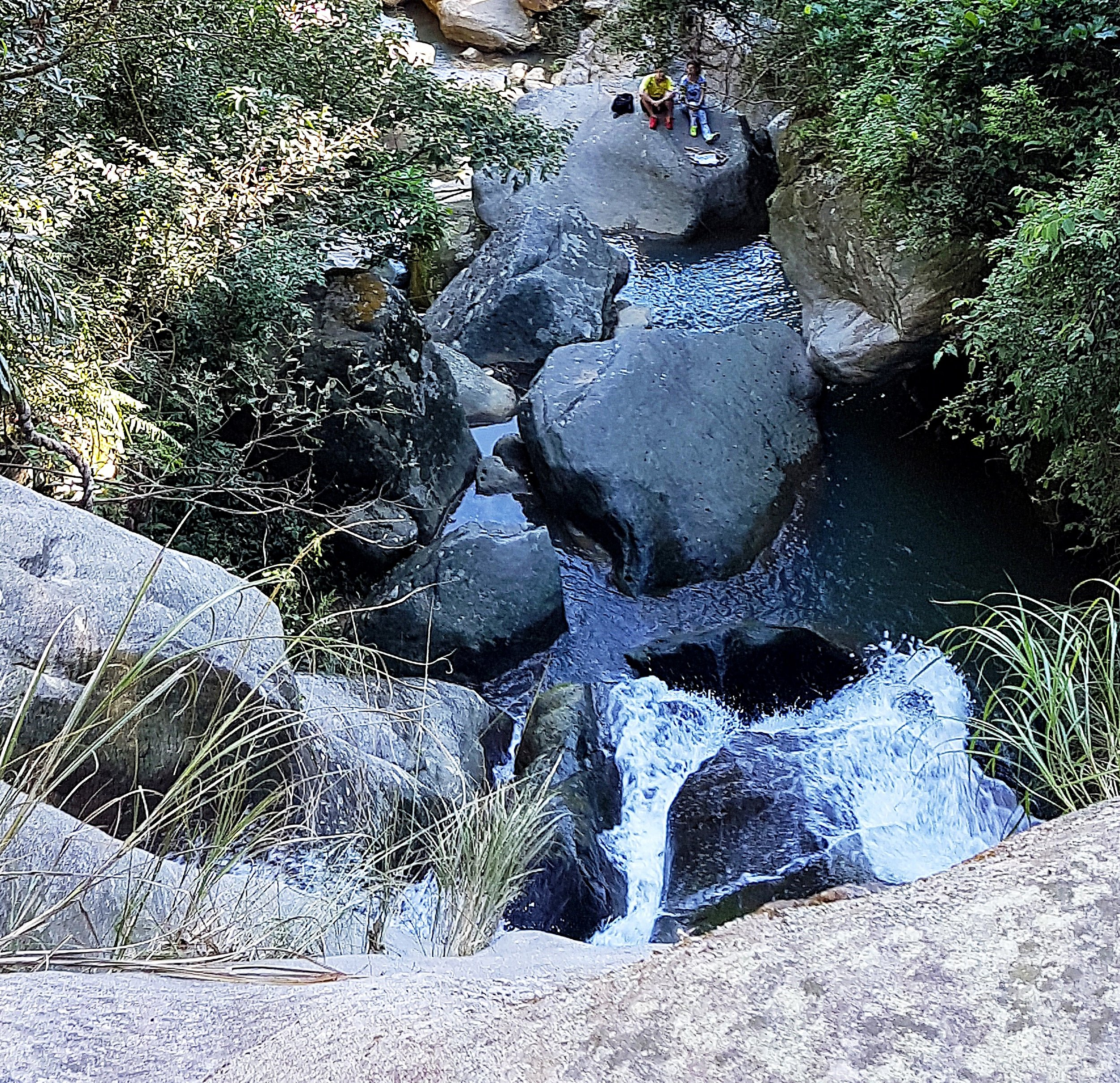 Looking over the top of the lower waterfall from the lip of the pool.
