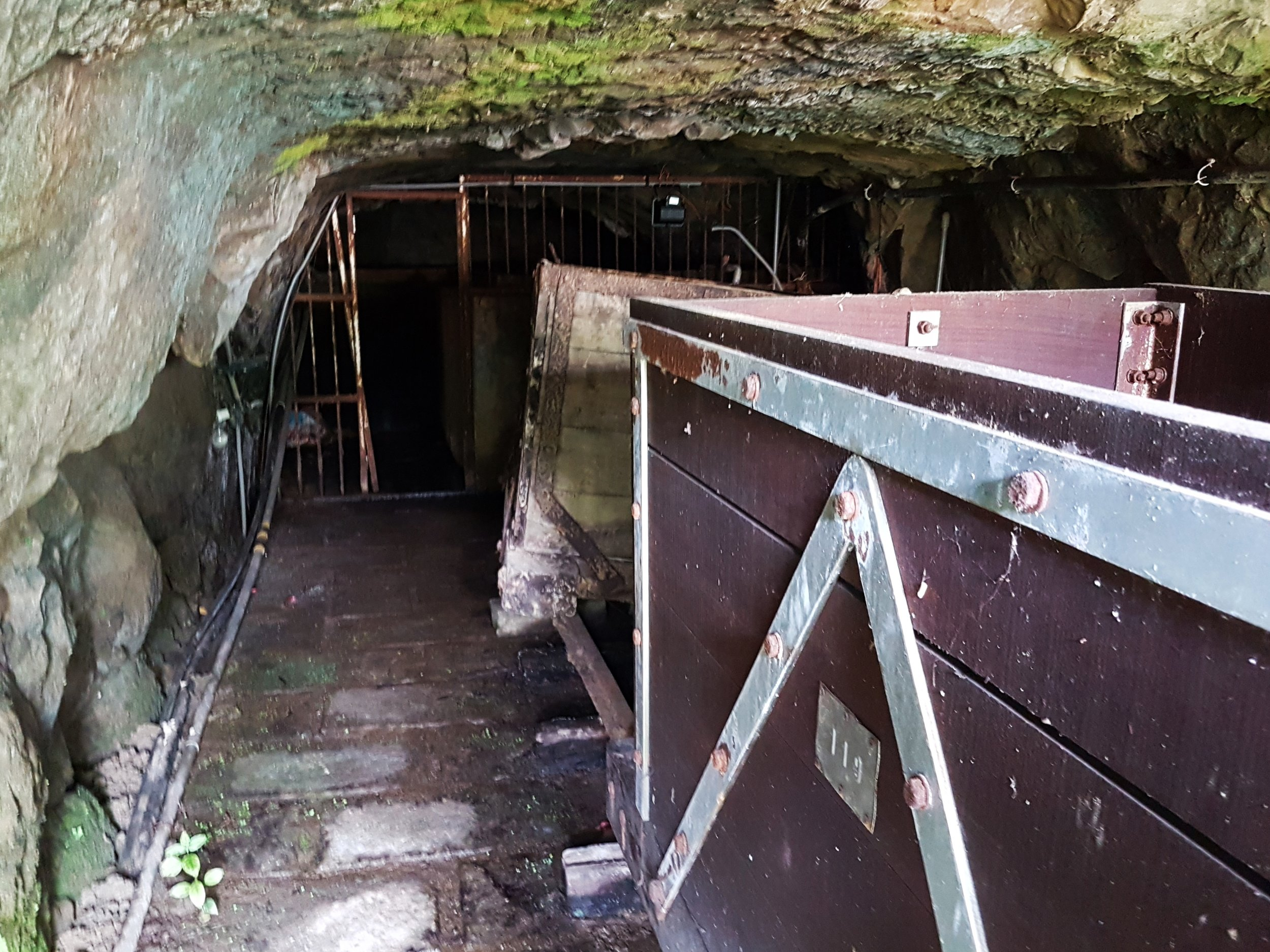 The carts on dry ground and the flooded deeper tunnel section.