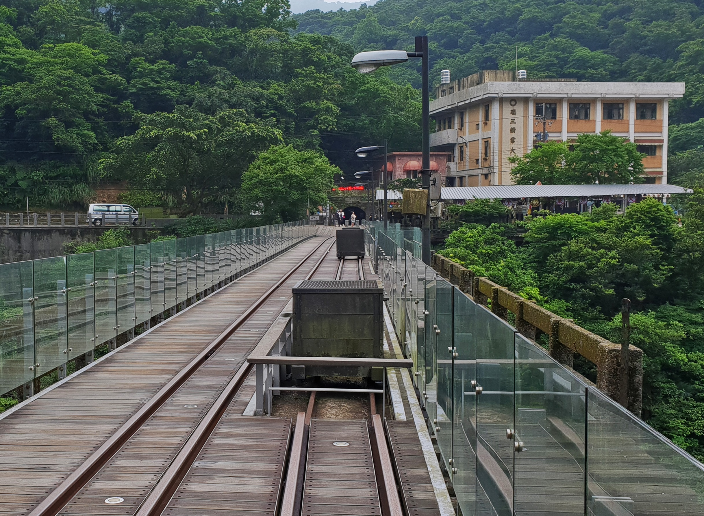 On the bridge with Houtong Mine and the Ruey-San Company Office Building ahead