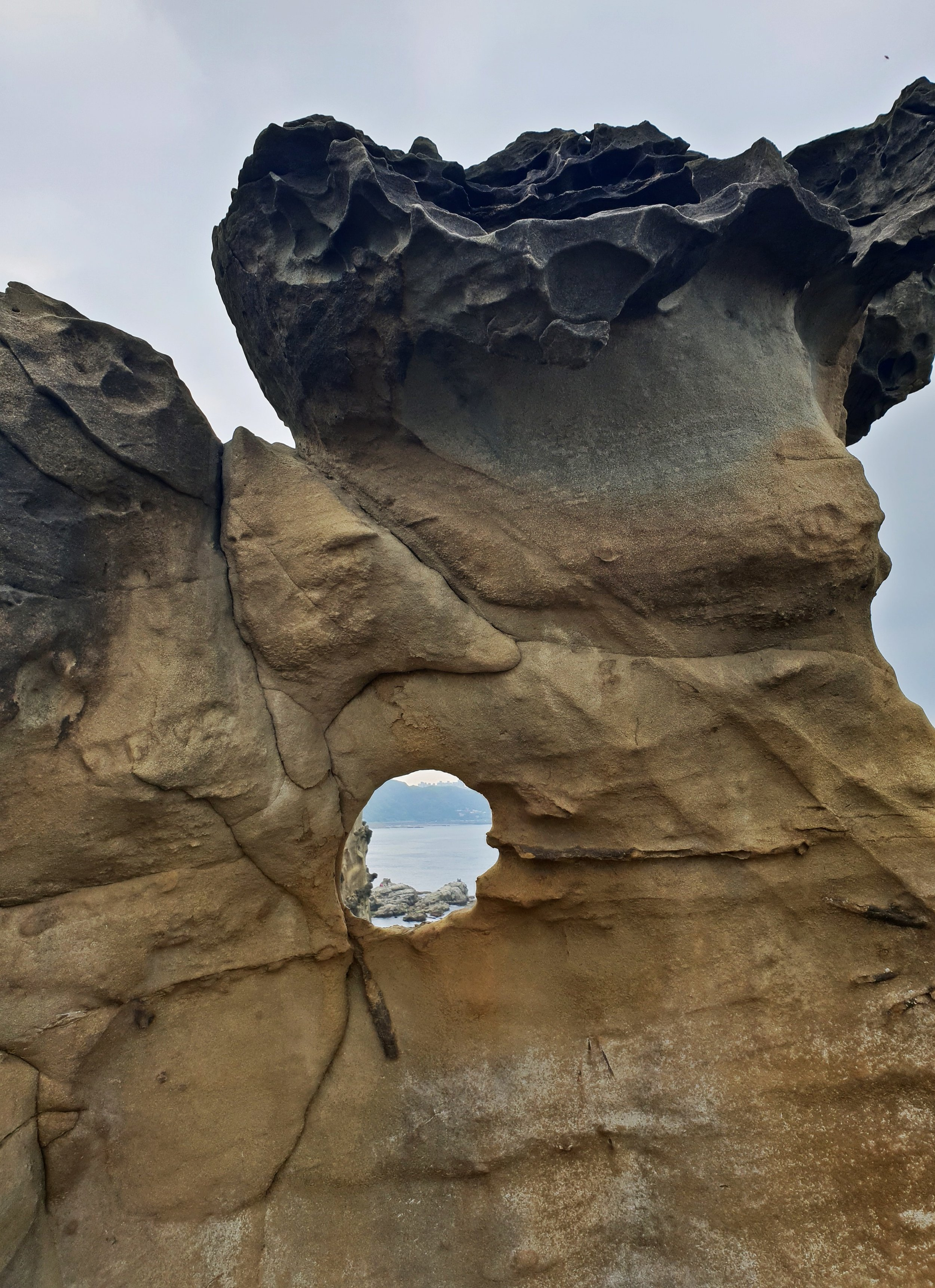 The rock is soft and easily eroded. An unusual rock porthole