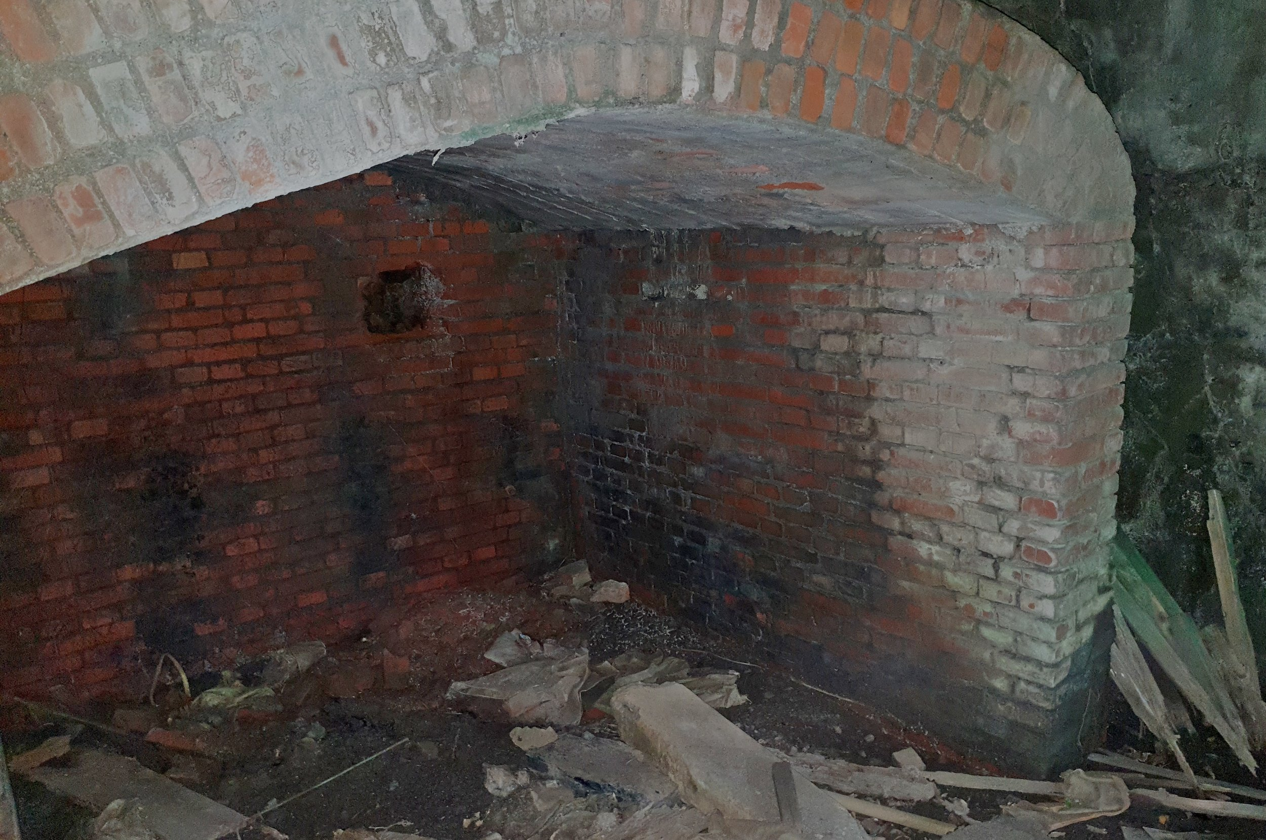 One bricked up tunnel. Not sure what these were for really as both have rock walls behind the bricks