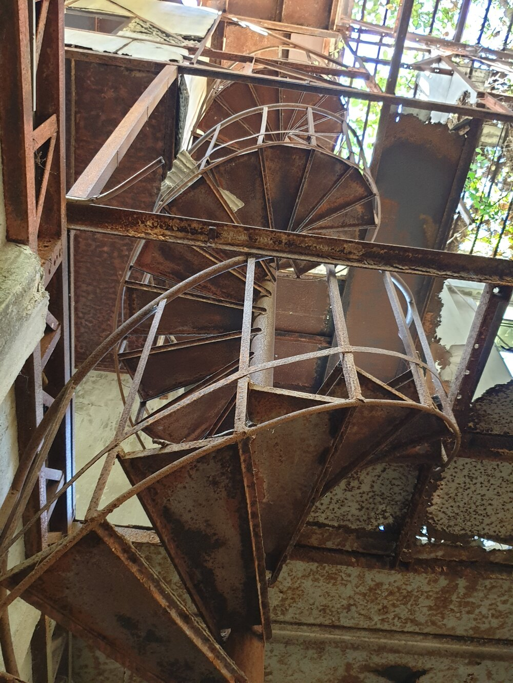 A badly rusted staircase that I did not climb