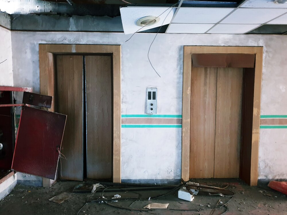 Arcade machines and broken elevators. On the left is the similarly abandoned Golden Horse Tower in Yuanlin