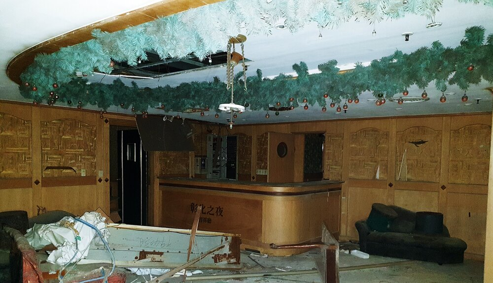 Christmas decorations in a dark nightclub and hotel rooms