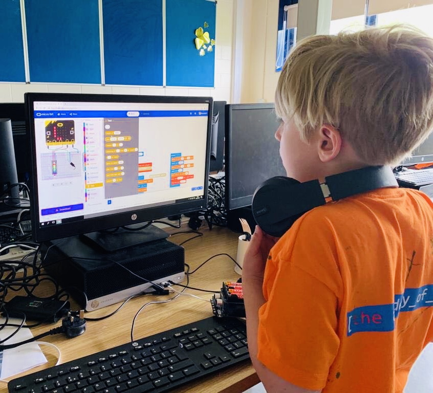 This Student is learning to code his robot using a micro:bit.  Did you know that a micro:bit is a pocket-sized computer 70 times smaller and 18 times faster than the original  BBC Micro  computers used in schools. It has 25 red LED lights that can flash messages and be used to create games.
