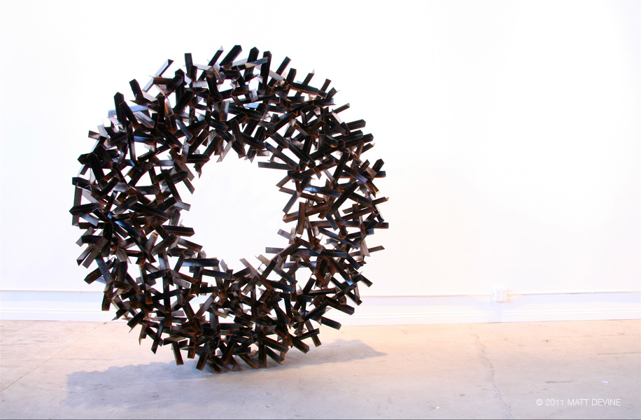 EMBRACE, 2011, steel with patina, 72H x 72W x 14D