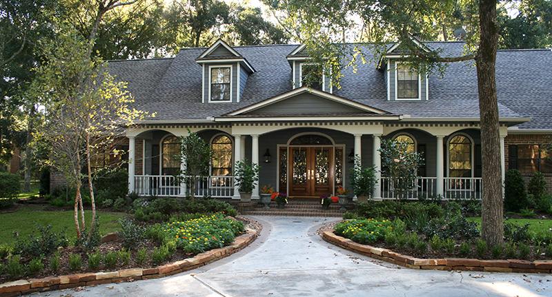 cottage-garden-with-river-birch,-camellia,-boxwood,-seasonal-color,-moss-rock-stacker-retaining-walls,-Magnolia-Texas.jpg