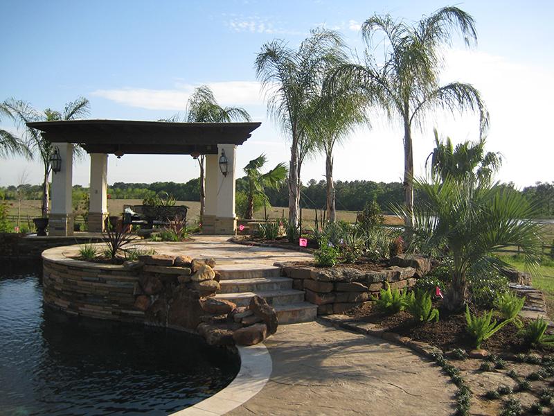 custom-pool-design-landscape-palms-flagstone-arbor-pergola-envy-exteriors-conroe-the-woodlands-spring-best.jpg