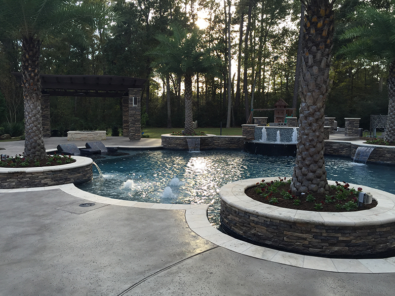 custom-pool-water-fire-bubblers-the-woodlands-houston-aggie-spring-conroe-hill-country-rustic-luxury-envy-cypress-montgomery-palm-travertine-concrete-best-gorgeous-pool-builder.jpg