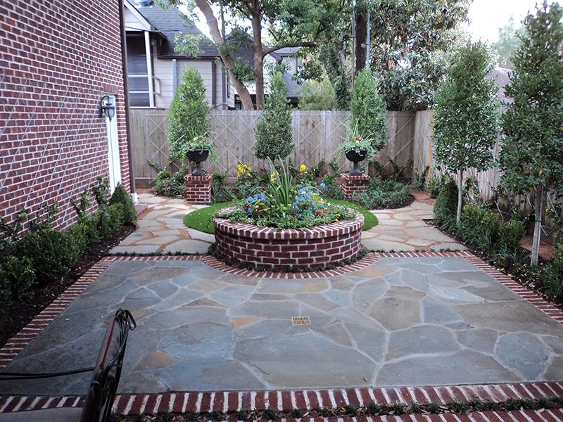 english-landscape-courtyard-boxwood-brick-red-landscaper-landscape-landscaping-ideas-best-company-builder-build-design-designer-hardscape-the-woodlands-cypress-houston-custom-ideas-montgomery-spring-urns-pottery-planter.jpg