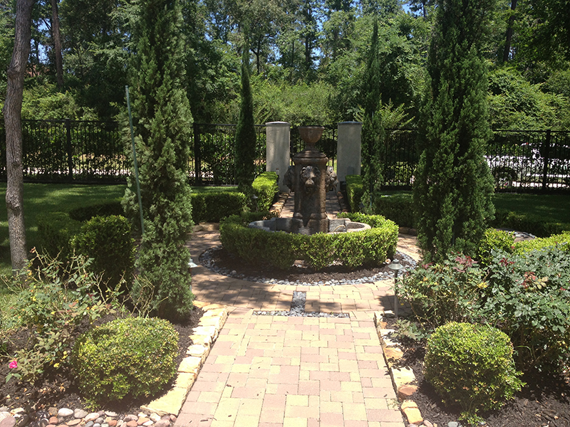 landscape-custom-design-houston-carlton-woods-the-woodlands-tx-cypress-magnolia-formal-luxury-landscaper-landscape-company-fountain-pavers-best-envy-exteriors-spring-wrought-iron-fence.jpg