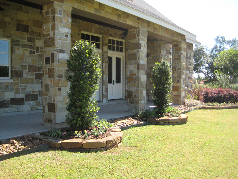 landscape-design-intall-stone-border-the-woodlands-tx-tomabll-spring-cypress.jpg