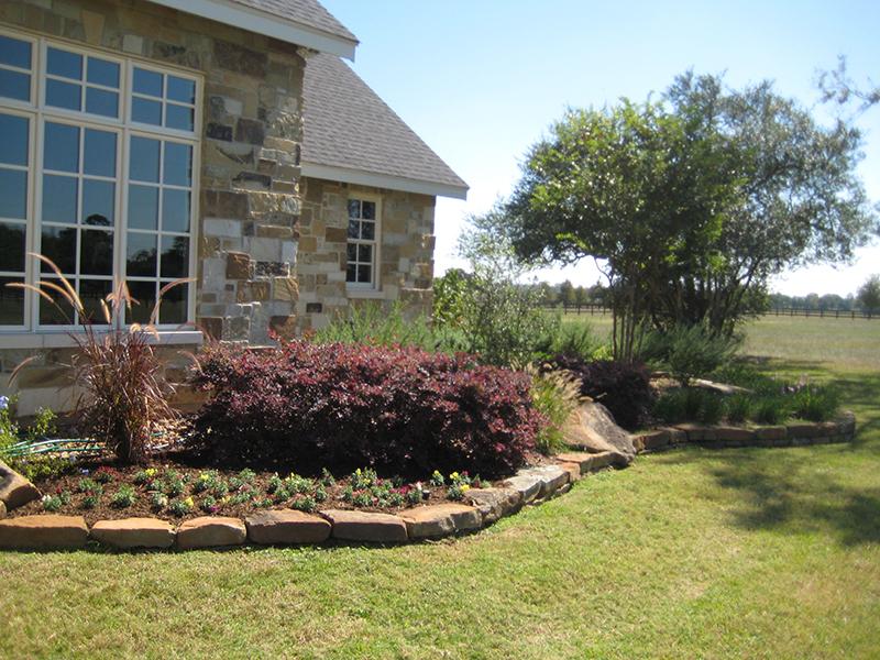 landscape-landscaper-magnolia-the-woodlands-install-design-stone-rock-border-maintenance-fertilization-envy-exteriors.jpg