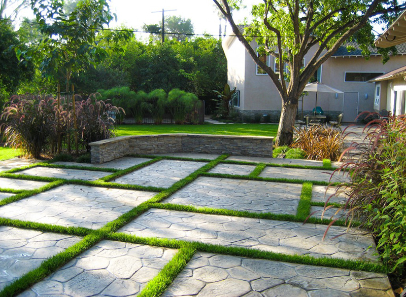 stamped-concrete-mondo-grass--landscape-patio-deck-retaining-wall-landscaper-installation-new-install-affordable-aggie-houston-the-woodlands-memorial.jpg
