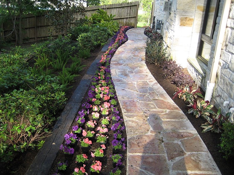 stone-walkway-pathway-landscape-french-country-formal-seasonal-landscaping-ideas-landsacper-installer-installation-plants-side-of-house-the-woodlands-best-envy-exteriors-spring-montgomery-spring-houston-cypress-conroe.jpg