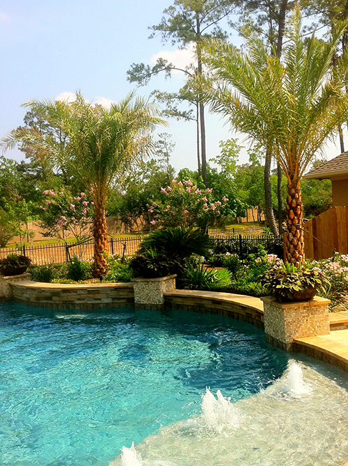 custom-pool-bubblers-planters-stone-flagstone-wall-contemporary-traditional-landsape-sheer-descent-waterfall-custom-design-woodforest-best-builder-the-woodlands-houston-spring-magnolia-conroe-montgomery-cypress.jpg
