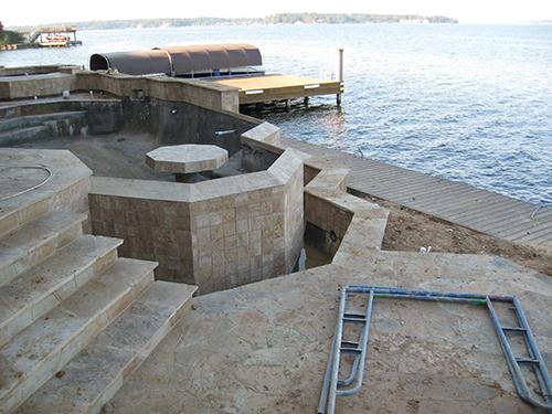 custom-pool-lake-conroe-conroe-on-lake-infinity-zero-edge-design-build-pool-builder-stone-table-in-pool-designer-architect-luxury-top-best-award-wining-the-woodlands-houston-spring-magnolia-conroe-montgomery-cypress.jpg