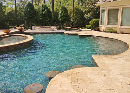 pool-design-cutom-travertine-pavers-decking-deck-waterfall-remodel-renovation-pebble-tec-firepit-seatng-wall-pool-builder-best-company-landscaping-woodforest-the-woodlands-houston-spring-magnolia-conroe-montgomery-cypress.jpg