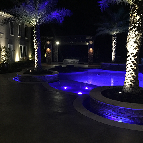 pool-lights-custom-pool-builder-construction-aggie-night-woodlands-spring-houston-tx-montgomery-colored-lighting-palm-planters-design-build-luxury-amazing-best.jpg