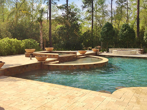travertine-pool-decking-new-pool-installation-fire-bowls-planter-pavers-versailles-peble-tec-pool-landscape-design-designer-architect-the-woodlands-houston-spring-magnolia-conroe-montgomery-cypress.jpg