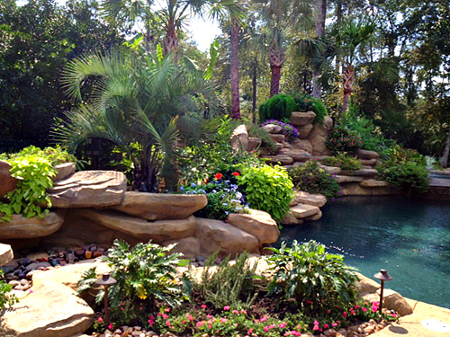 trpoical-pool-large-waterfalls-luxury-carlton-woods-builder-pool-builder-landscape-landscaping-new-design-designer-best-top-pebble-tec-the-woodlands-houston-spring-magnolia-conroe-montgomery-cypress.jpg