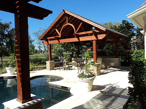 Western-red-cedar-pergola-with-8x8-posts,-4x12-beams,-2x6-joist-and-composite-roof,-Humble-Texas.jpg