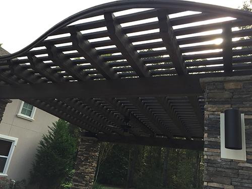arbor-pergola-cedar-espresso-stained-outdoor-landscaper-landscape-builder-build-design-installation-the-woodlands-covered-houston-spring-montgomery-conroe-cypress-tx-stone.jpg
