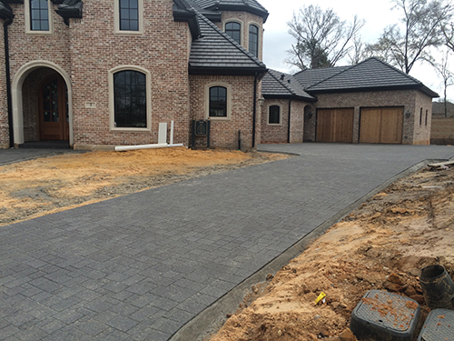 custom-paver-driveway-cobblestone-dark-gray-install--design-build-the-woodlands-carlton-woods-magnolia-cypress-contemporary-modern-best-envy-exteriors-pavers-best-installer-landscaper-new-home-construction-aggie-owned-family-company.jpg