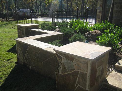 Custom-Stone-Installation-stone-seating-wall-flagstone-landscape-pool-the-woodlands-houston-tx-houston.jpg