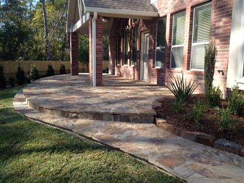 flagstone-hacket-patio-deck-outdoor-seating-lighting-sky-pencil-landscaping-landscape-hardscape-design-build-company-commerical-residential-best-woodforest-the-woodlands-houston-spring-magnolia-conroe-montgomery-cypress.jpg