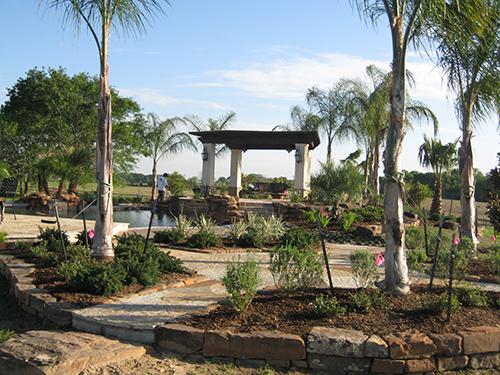 flagstone-moss-rock-stone-pool-outdoor-kitchen-stairs-landscape-landscaper-landscaping-custom-design-designer-build-builder-best-aggie-the-woodlands-houston-spring-magnolia-conroe-montgomery-cypress.jpg