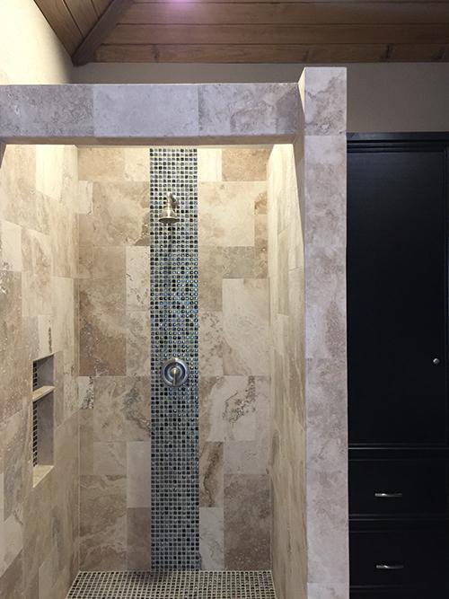 outdoor_-bathroom-pool-cabana-shower-pool-house-travertine-glass-bead-black-cabinets-the-woodlands-spring-tx-houston-custom-design-luxury-best-builder-envy-tiramisu-landscape-company-aggie-glass-bead-pool-bath.jpg