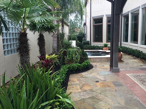 outdoor-kitchen-living-the-woodlands-spring-flagstone-dark-arbor-stain-design-build-envy-exteriors-houston.jpg