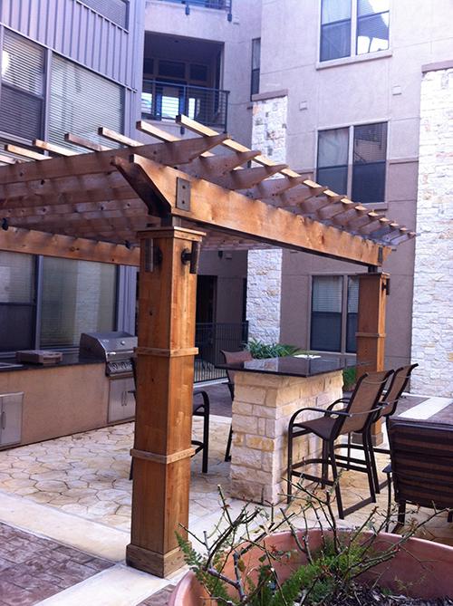 outdoor-kitchen-pergola-arbor-stone-design-build-construction-cedar-the-woodlands-spring-magnolia-cypress-envy.jpg
